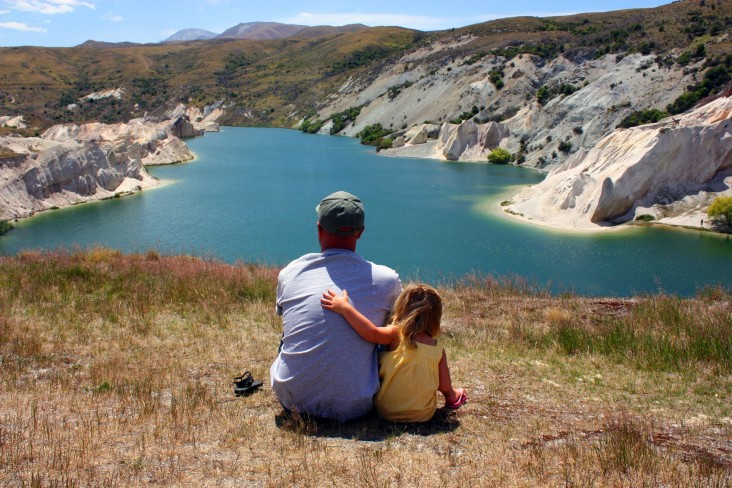 Why high income households get benefits, photo of father and child looking out to St Bathans, South Island
