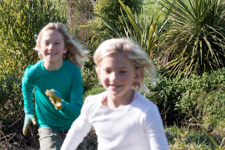 Photo of children running through riparian border - from NZ Story Group